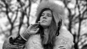 Janis Joplin, posed, smoking cigarette (Photo by Jan Persson/Redferns)